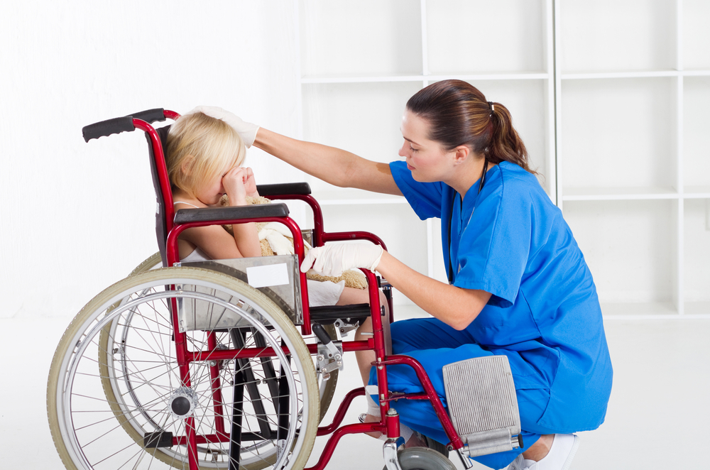 Child in wheelchair with nurse